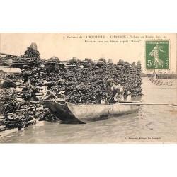 """ABAO 17 - Charente-Maritime [17] Charron - Pêcheur de moules dans les bouchots avec son bateau appelé """"Accon""""."""