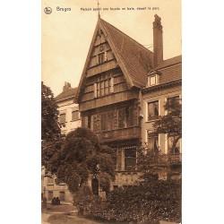 Flandre occidentale Bruges - Maison ayant une façade en bois, devant le parc.